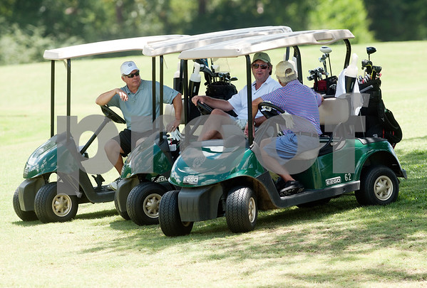 Joe Cavender, left, Jackie Lee, center, and Harry A. Leatherwood, right, pass time on their golf carts waiting to tee on the third hole during the Men's Club Golf Championship at Willow Brook Country Club in Tyler Friday July 17, 2015. The annual event got underway Friday with a championship flight of 54 holes. The other flights are 36-holes and will begin on Saturday. The event concludes Sunday.   (photo by Sarah A. Miller/Tyler Morning Telegraph)