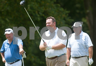 Don Robert Johnson, left,  Aaron Hickman, center, and Joel Hackney, right, wait to tee during the Men's Club Golf Championship at Willow Brook Country Club in Tyler Friday July 17, 2015. The annual event got underway Friday with a championship flight of 54 holes. The other flights are 36-holes and will begin on Saturday. The event concludes Sunday.   (photo by Sarah A. Miller/Tyler Morning Telegraph)
