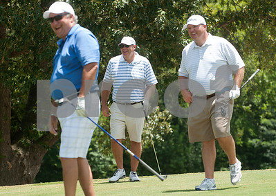 Don Robert Johnson, left, Joel Hackney, center, and Aaron Hickman, right, enjoy laugh on third tee during the Men's Club Golf Championship at Willow Brook Country Club in Tyler Friday July 17, 2015. The annual event got underway Friday with a championship flight of 54 holes. The other flights are 36-holes and will begin on Saturday. The event concludes Sunday.   (photo by Sarah A. Miller/Tyler Morning Telegraph)
