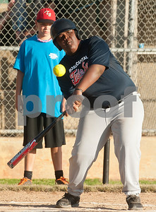 Rose Capital Tyler East Challenger Division player Tyronw Battise bats during their game against Santa Fe in the 46th annual Texas East State Little League Tournament Saturday July 18, 2015 at Faulkner Park in Tyler, Texas. This is the13th year Tyler has hosted the event. Challenger Division teams have both male and female players from ages 4 through high school students who have mental or physical special needs.  (photo by Sarah A. Miller/Tyler Morning Telegraph)