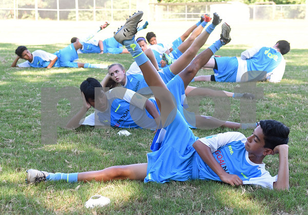 Shahan Ahmed, 13, of Tyler, and other campers learn new stretches at One Soccer, a week-long camp held at Robert E. Lee High School Wednesday July 20, 2016.  (Sarah A. Miller/Tyler Morning Telegraph)