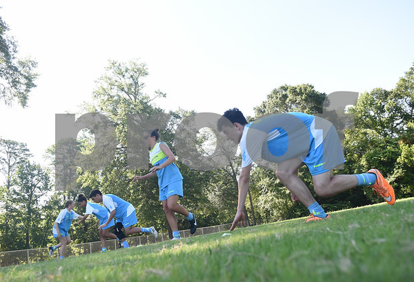 John Kennedy, 16, of Tyler, and other campers, do a drill at One Soccer, a week-long camp held at Robert E. Lee High School Wednesday July 20, 2016.  (Sarah A. Miller/Tyler Morning Telegraph)