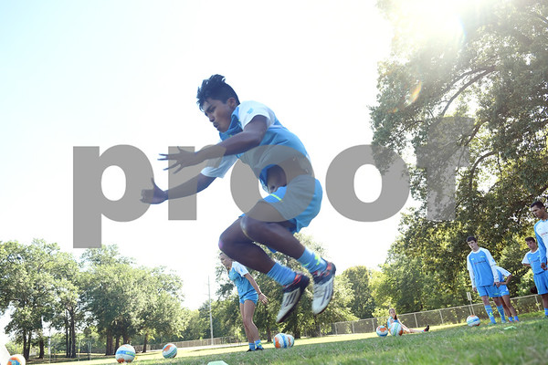 Josh Cornelio, 16, jumps during a drill at One Soccer, a week-long camp held at Robert E. Lee High School Wednesday July 20, 2016.  (Sarah A. Miller/Tyler Morning Telegraph)