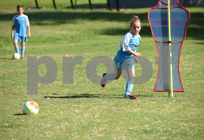 Lexya Purvis, 9, of Tyler, does a drill at One Soccer, a week-long camp held at Robert E. Lee High School Wednesday July 20, 2016.  (Sarah A. Miller/Tyler Morning Telegraph)
