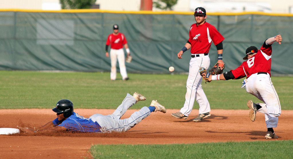 . The ball gets away from Nicholas Novak of the Ironmen as Jace Mercer of Cincinnati slides into second safely. Randy Meyers -- The Morning Journal