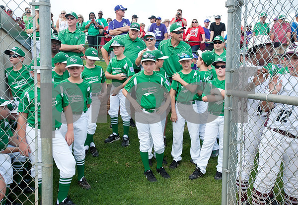 photo by Sarah A. Miller/Tyler Morning Telegraph  Two Washington County little league teams wait to take the field for the opening ceremonies of the 44th Annual Texas East League State Tournament Saturday at Faulkner Park in Tyler. This is the 11th year the tournament has been held in Tyler.
