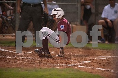 photo by Sarah A. Miller  Pearland's (5) Adam Houghtaling slides into home base during their game against Sweeny in the Texas East Little League State Tournament  Saturday night at Faulkner Park in Tyler. This is the 11th straight year the tourney has been held in Tyler.
