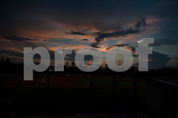 photo by Sarah A. Miller  Stormy skies delayed games during the Texas East Little League State Tournament  Saturday night at Faulkner Park in Tyler. This is the 11th straight year the tourney has been held in Tyler.