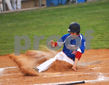 Tyler East Seniors second baseman Landry Mayo slides home on Sunday afternoon during a Little League State Tournament matchup against West University. (Victor Texcucano)
