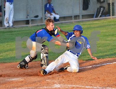Tyler East Juniors catcher Campbell Miller slaps a tag on a runner attemting to score. (Victor Texcucano)
