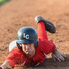 The Ironmen's Mathew Carpenter slides safely back to first base on a pick-off attempt. Eric Bonzar — The Morning Journal