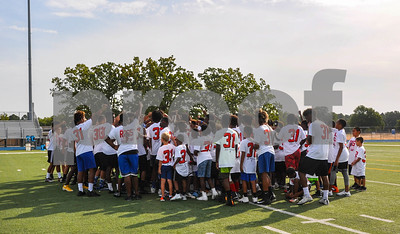 Campers huddle together at the Aaron Ross Football Camp on Saturday, July 21. The camp was held at John Tyler High School. (Jessica T. Payne/Tyler Paper)