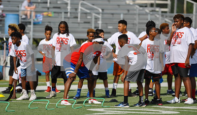 Former NFL player Aaron Ross faces off with an area athlete at his camp, hosted by CHRISTUS Trinity Mother Frances, on Saturday, July 21. The camp was held at John Tyler High School in Tyler. (Jessica T. Payne/Tyler Paper)