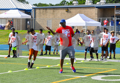 Titus Hardy helps coach a football camp at John Tyler High School on Saturday, July 21. The camp was put on by former NFL player Aaron Ross. (Jessica T. Payne/Tyler Paper)