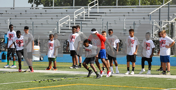 Former NFL player Aaron Ross runs drills with area athletes at his football camp held at John Tyler High School. The camp took place on Saturday, July 21 and was hosted by CHRISTUS Trinity Mother Frances. (Jessica T. Payne/Tyler Paper)