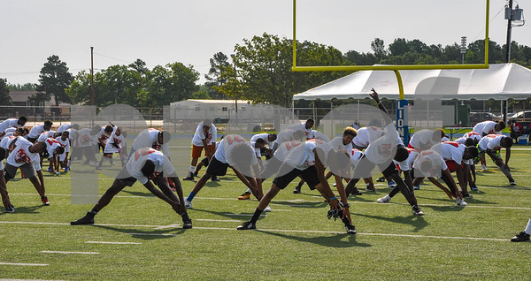 Area athletes stretch prior to starting a football camp put on by former NFL player Aaron Ross and hosted by CHRISTUS Trinity Mother Frances. The camp took place at John Tyler High School on Saturday, July 21. (Jessica T. Payne/Tyler Paper)