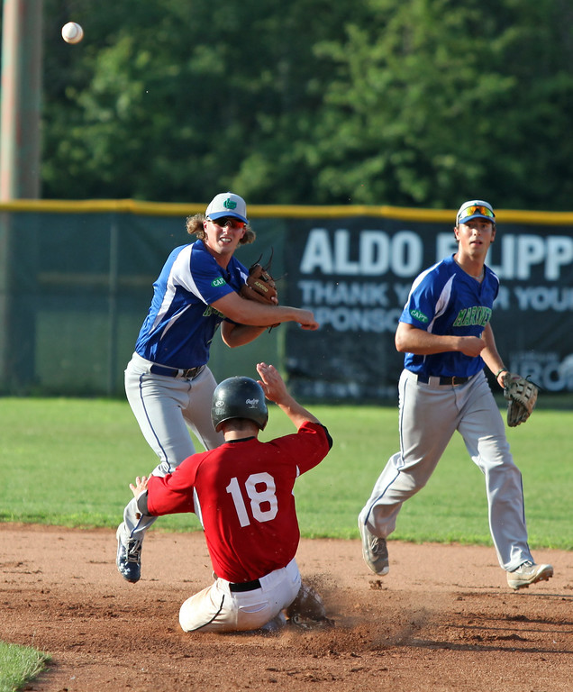 . Randy Meyers - The Morning Journal<br> Caleb Waller of the Ironmen tries to break up a double play as he slides into Cole Womack of Grand Lake at second base on July 22.