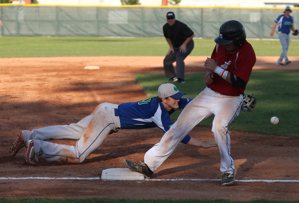 . Randy Meyers - The Morning Journal<br> Nicholas Novak of the Ironmen steps back to third as the throw gets by Joe Aeilts of Grand Lake on July 22.