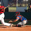 Antonio Bennett of the Ironmen lines a base hit up the middle against Lima. Randy Meyers -- The Morning Journal
