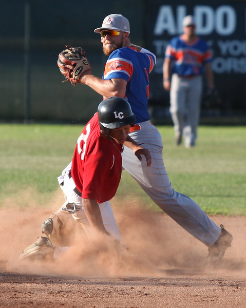 Richard Philipps of the Ironmen slides hard into second in an attempt to break up a double play with Lima infielder Colin Stolly. Randy Meyers -- The Morning Journal