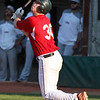 Canyon McWilliams flies out to the outfield against Lima. Randy Meyers -- The Morning Journal