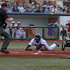L.J. Kalawaia slides into home safely and scores the first run against Florence. Randy Meyers -- The Morning Journal