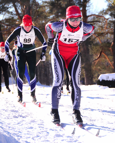 Andrea Vogl, of Shelburne, VT (#157), stays just ahead of Rosalie Lipfert (#99)of Hanover, NH, during The 7th Annual White Mountain Classic 30K ski race, which hosted by the Jackson Ski Touring Foundation, on January 22nd, 2011, in Jackson, NH. Over 200 competitors used the classic cross-country ski technique in a 30 kilometer (18.64 miles) marathon on the trail systems in and around Jackson Village.