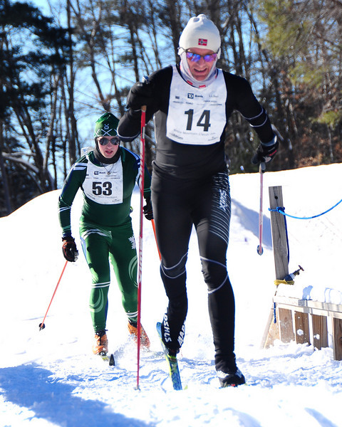 Odd-Aage Bersvendsen (#14), of Jackson, NH, crosses a bridge, followed closely by Deb Duncanson, of West Newbury, MA, during The 7th Annual White Mountain Classic 30K ski race, which was hosted by the Jackson Ski Touring Foundation, on January 22nd, 2011, in Jackson, NH. Over 200 competitors used the classic cross-country ski technique in a 30 kilometer (18.64 miles) marathon on the trail systems in and around Jackson Village.