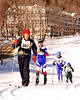 Racing up a steep hill are (left to right) Alex Spies, Nick Demosthenes, both of the Mt. Ararat (Maine) Ski Team, Ann Burnham, of Carlisle, MA, and Alice Bradley, of Chugiak, Alaska, during The 7th Annual White Mountain Classic 30K ski race, which was hosted by the Jackson Ski Touring Foundation, on January 22nd, 2011, in Jackson, NH. Over 200 competitors used the classic cross-country ski technique in a 30 kilometer (18.64 miles) marathon on the trail systems in and around Jackson Village.