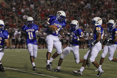 Pflugerville's Malachi Bowser  celebrates after an interception during Friday nights game.