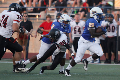 Pflugerville's Adrian Dilworth runs the ball against Bowie during Friday nights game.