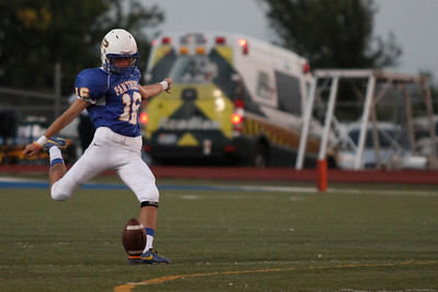 Pflugerville's Josh Lanno kicks the ball to Bowie during Friday nights game.