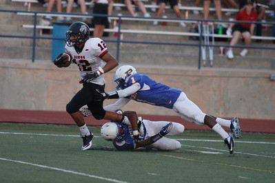 Pflugerville's Jay Byrd and Jacon Sowell tackle Bowies John Subia