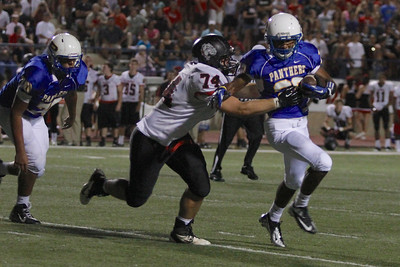 Pflugerville's Nick Bowens runs the ball against Bowie during Friday nights game.