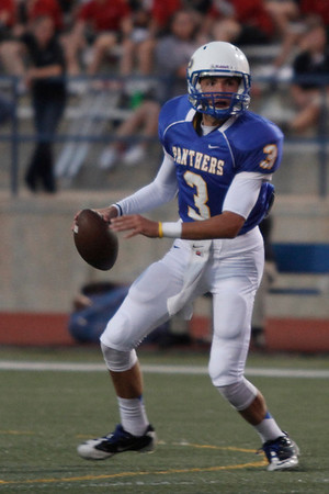 Pflugerville's Blain Kruemcke looks to throw the ball against Bowie during Friday nights game.