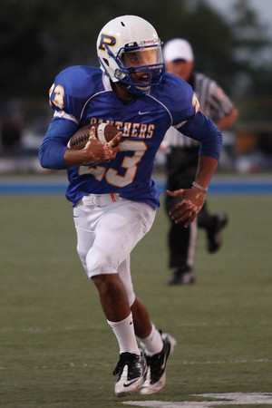 Pflugerville's Clarence Guidry runs the ball against Bowie during Friday nights game.