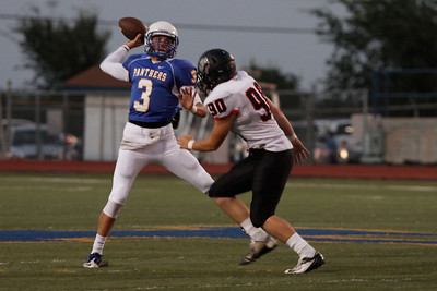 Pflugerville's Blain Kruemcke throws the ball against Bowie during Friday nights game.