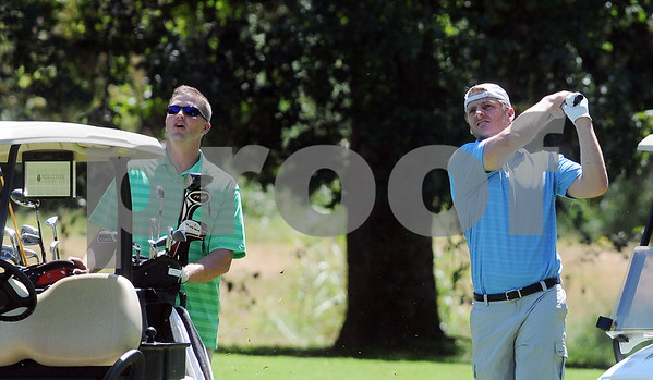 copyright 2012 Sarah A. Miller/Tyler Morning Telegraph  Former Texas A&M quarterback Randy McCown of Jacksonville, left, watches as his golf partner Rich Coady of Dallas plays the third hole at Hollytree Country Club in Tyler Monday during the Texas A&M Golf Tournament.