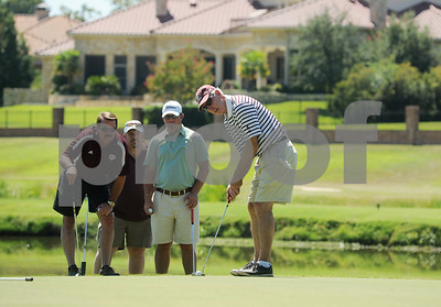 copyright 2012 Sarah A. Miller/Tyler Morning Telegraph  Former Texas A&M head football coach R.C. Slocum putts on the fourth green at Hollytree Country Club in Tyler Monday during the Texas A&M Golf Tournament. Also pictured from left to right are: Dane Hendley, William Bass, and John Slocum.
