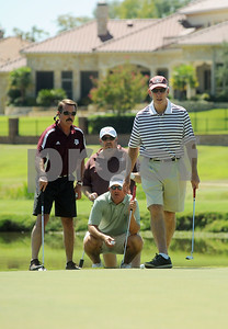 copyright 2012 Sarah A. Miller/Tyler Morning Telegraph  Former Texas A&M head football coach R.C. Slocum prepares to putt on the fourth green at Hollytree Country Club in Tyler Monday during the Texas A&M Golf Tournament. Also pictured from left to right are: Dane Hendley, William Bass, and John Slocum.
