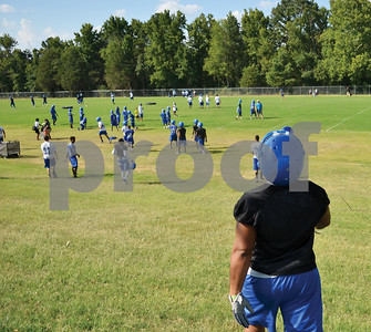 John Tyler High School football players make their way to commence the first practice of the 2013 season on Monday afternoon. (Victor Texcucano)