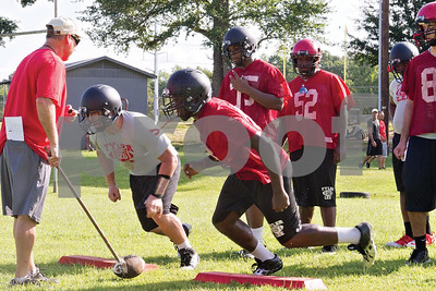 Photo by Shannon Wilson / Tyler Morning Telegraph Robert E. Lee High School football players participate in their first practice of the season on the practice field Monday morning.