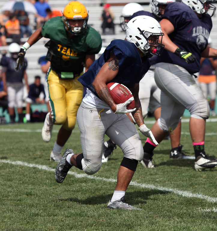 . Lorain running back Dakota Mincy runs right for a big gain against Amherst. Randy Meyers -- The Morning Journal