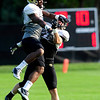 CU cornerback Josh Moten (left) knocks the ball away from defensive back Parker Orms (right) during practice at the University of Colorado in Boulder, Colorado August 14, 2012.  DAILY CAMERA MARK LEFFINGWELL