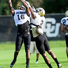 CU defensive back Jeffery Hall (left) catches the ball while being defended by cornerback Kenneth Crawley (right) during practice at the University of Colorado in Boulder, Colorado August 14, 2012.  DAILY CAMERA MARK LEFFINGWELL