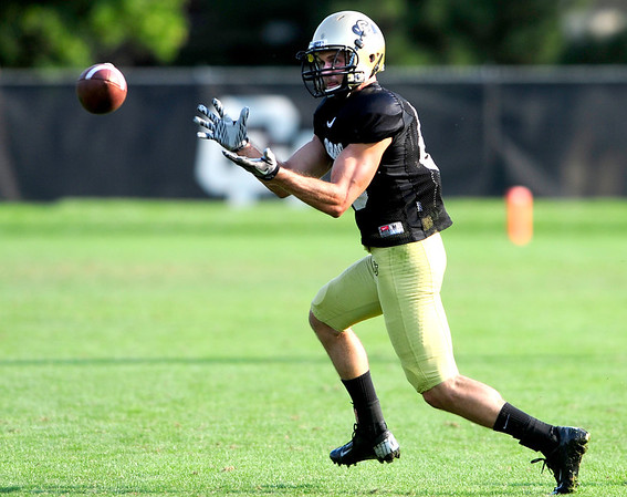 CU wide receiver Alex Turbow catches a pass during practice at the University of Colorado in Boulder, Colorado August 14, 2012.  DAILY CAMERA MARK LEFFINGWELL