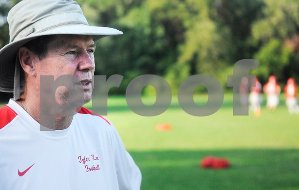 New Lee head football coach Darrell Piske keeps an eye on the Red Raiders at their first practice Monday morning. Herb Nygren Jr 081312