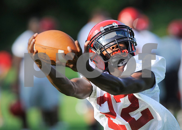 Lee receiver Bryce Wilkerson makes the catch at the Red Raiders'  first practice Monday morning. Herb Nygren Jr 081312