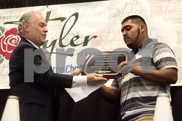 Dr. Matt Jones gives Jacksonville's Sergio Cabrera the East Texas Team Community Service Award at the 12th annual East Texas Kick-off Luncheon at Harvey Convention Center in Tyler, Texas, on Tuesday, Aug. 15, 2017. Hundreds gathered to enjoy a meal together to listen to speakers and kick off the 2017 football season. (Chelsea Purgahn/Tyler Morning Telegraph)