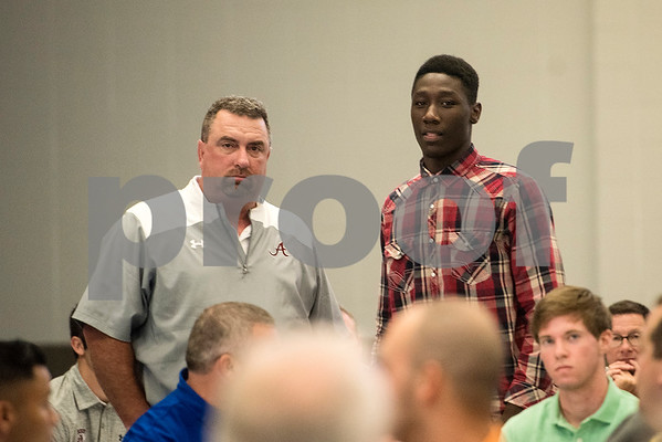 Arp head coach Dale Irwin and Demarvion Overshown stand to be recognized during the 12th annual East Texas Kick-off Luncheon at Harvey Convention Center in Tyler, Texas, on Tuesday, Aug. 15, 2017. Hundreds gathered to enjoy a meal together to listen to speakers and kick off the 2017 football season. (Chelsea Purgahn/Tyler Morning Telegraph)